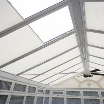 white pleated conservatory blinds