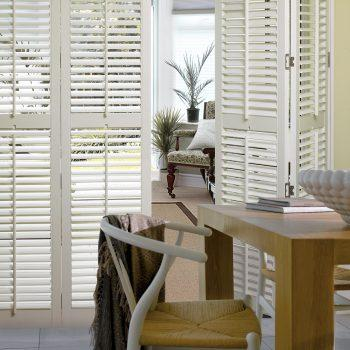 white bi-folding door blinds