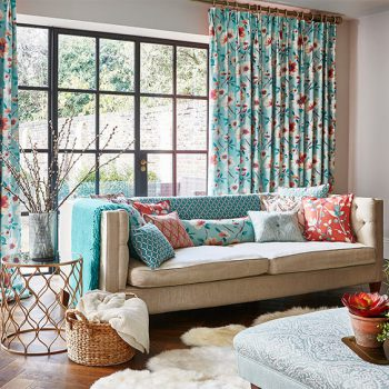 printed curtains and matching cushions